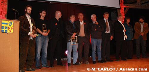 Paolo Cossi, Sébastien Cosset, Midam, Hermann, Jean Van Hamme, Raoul Cauvin et Jean Dufaux entouré de politiques.